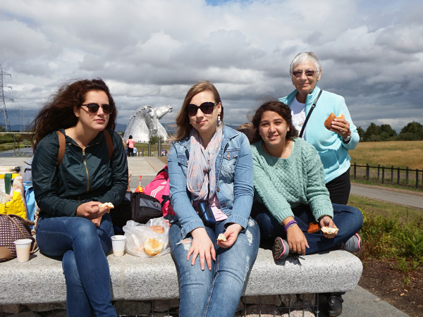 Ena from Croatia, Vanessa from Brazil and Sivan from Israel with Ann when they visited the Kelpies near Falkirk last year.