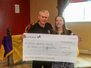 Consett Lions Club President Jim Alderson presenting a cheque for £2,500 to Katherine Cooper, Income Generation Director, Willow Burn Hospice, County Durham. The money was raised by the Club holding a Charity Concert in memory of the late Lion Eric James MJF.