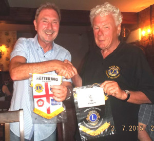 Morpeth Lion President Stuart Lewis and Keith exchange Club banners