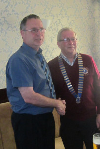 Former President Stuart Lewis (left) handing over to new President Ian Brown