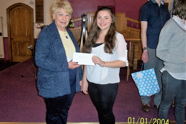 Lion VP Margaret Trewick presents a cheque to Deborah Snowdon