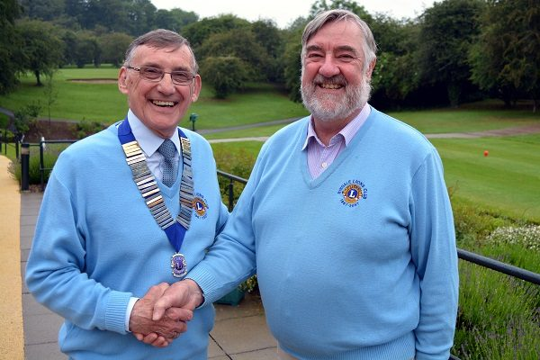 New President of the Ryedale Lions, David Warin, wearing the chain of office, with retiring President, Jim Ingham.