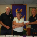 Lion Chris Atkinson,Lioness President Chris Wall,and Lion John Boulton from Wetherby Lions presenting a cheque to Northallerton and District Lioness Group for £600.00